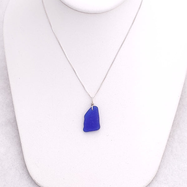 Cobalt blue sea glass with silver wire wrapped bail on box chain.