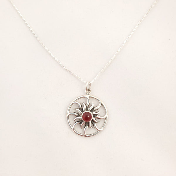 Silver sunburst with curvy rays necklace on box chain