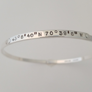 Silver bangle bracelet with the coordinates of York, Maine