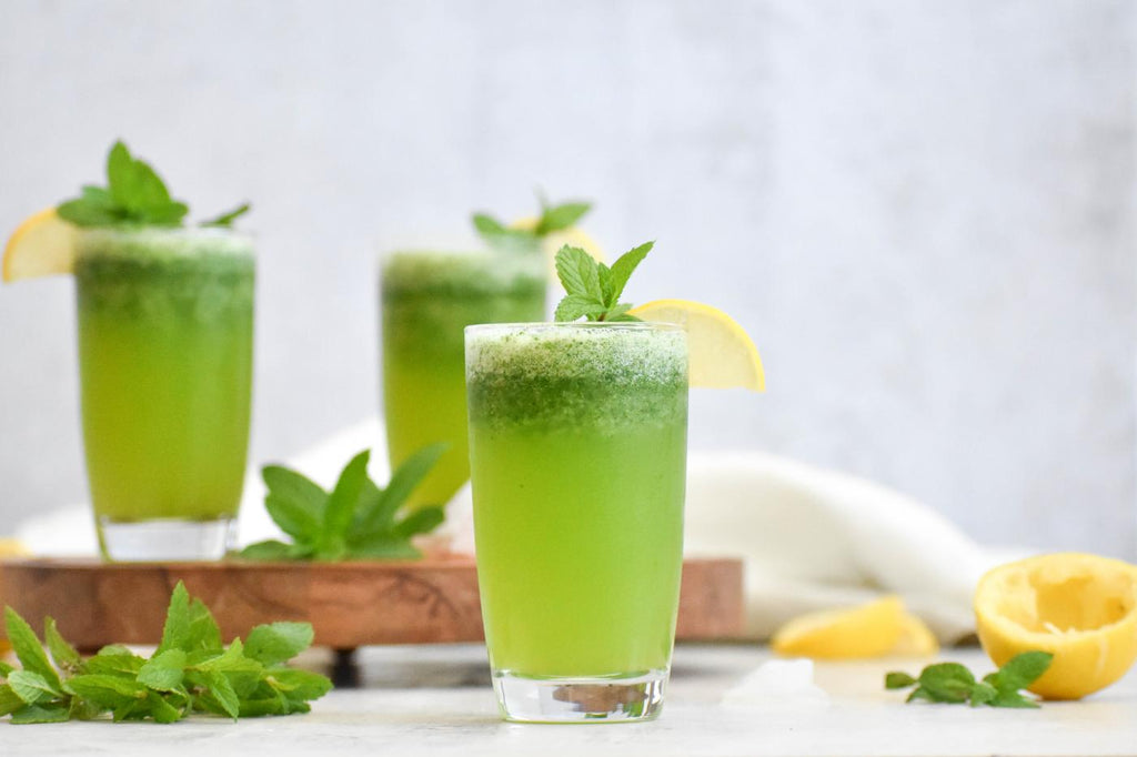 A green drink garnished with peppermint.