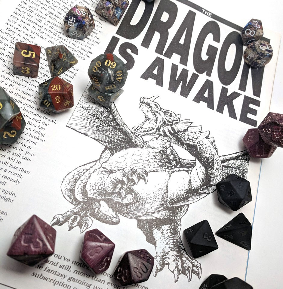 Dragon is Awake news article with Level Up Dice