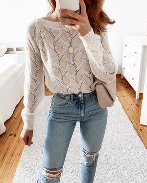 Knit sweater with a lace pattern