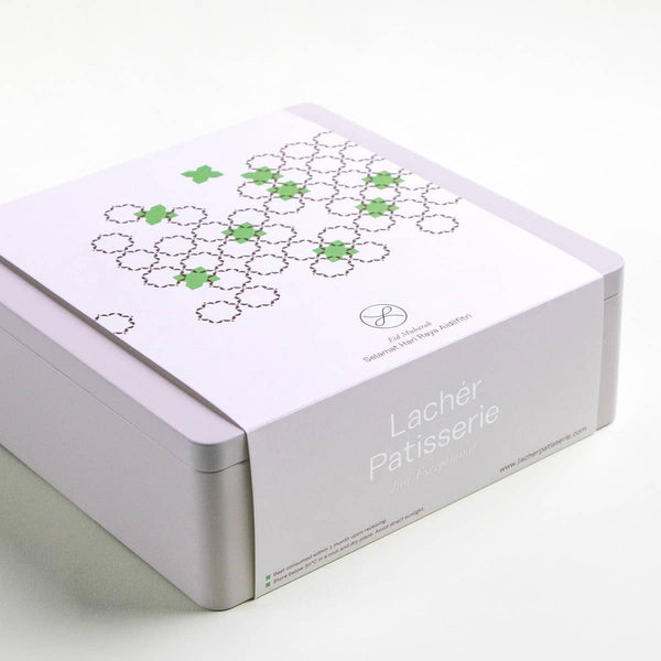 A 2021 Hari Raya Aidilfitri Gift Box in cream with a white sleeve and pops of green