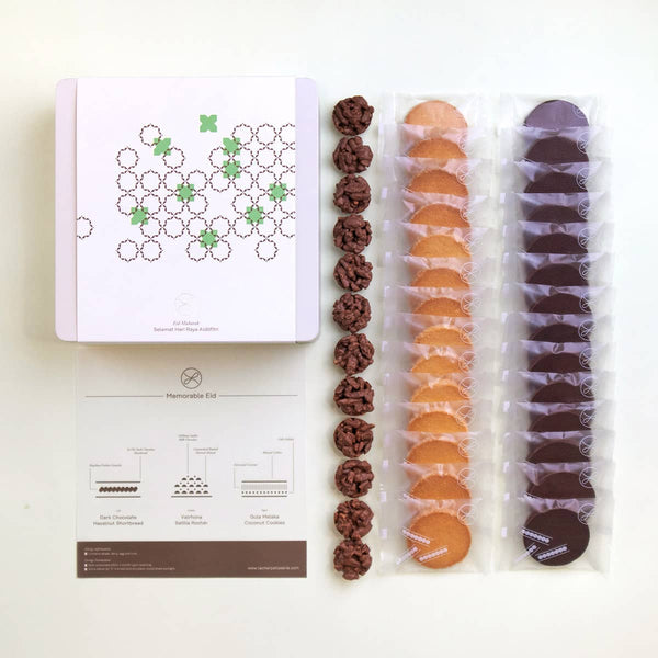 A 2021 Hari Raya gift box, a paper describing its components and 3 types of Hari Raya cookies in rows on three.