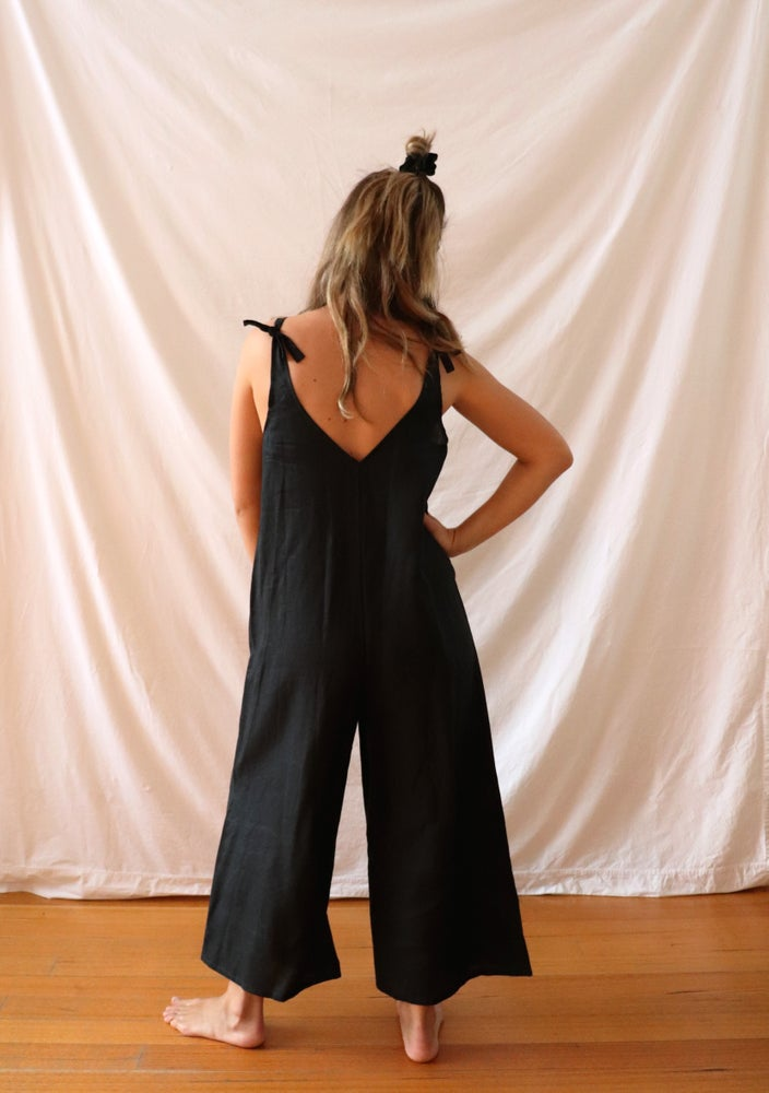 Ethically made black linen jumpsuit with adjustable shoulder tie.