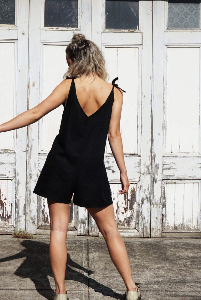 Ethically made black linen short jumpsuit with adjustable shoulder tie.