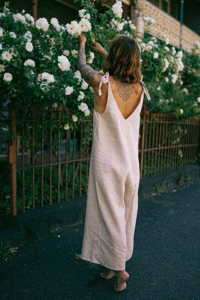 Ethically made beige linen jumpsuit with adjustable shoulder tie.
