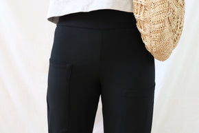 ethically made black stretch pants with pockets and three-quarter cuff. close up