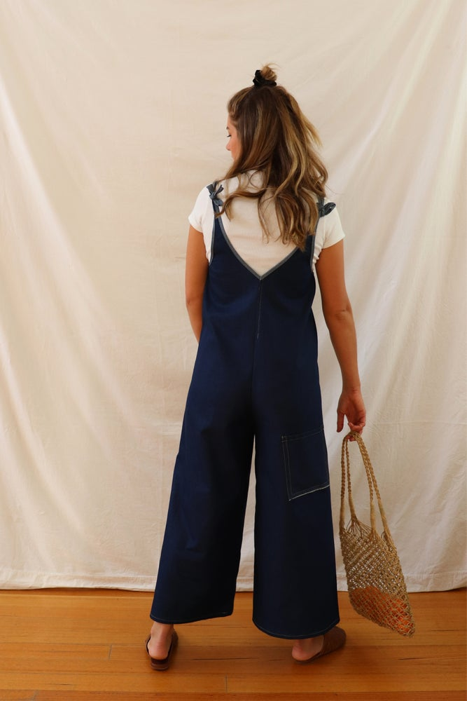 Ethically made blue denim linen jumpsuit with adjustable shoulder tie.