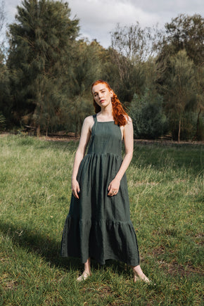 A maxi style dress made in a heavy weight 100% Belgium linen in a forest green colour. An elegant square high neckline with a open cross strap back. A luxurious ruffle hems the dress for a floaty feel. Designed and handmade in Melbourne by mother daughter team.