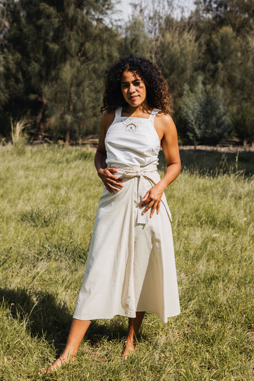Ethically made beige linen wrap long skirt with ties to adjust fit.