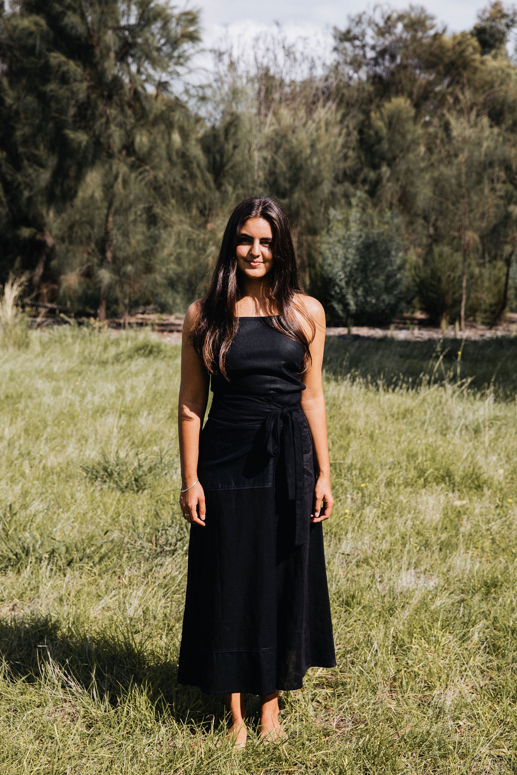 Ethically made black linen wrap long skirt with ties to adjust fit.