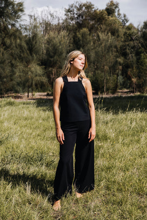 Ethically made black cotton stretch pants with wide leg and stretch waistband.
