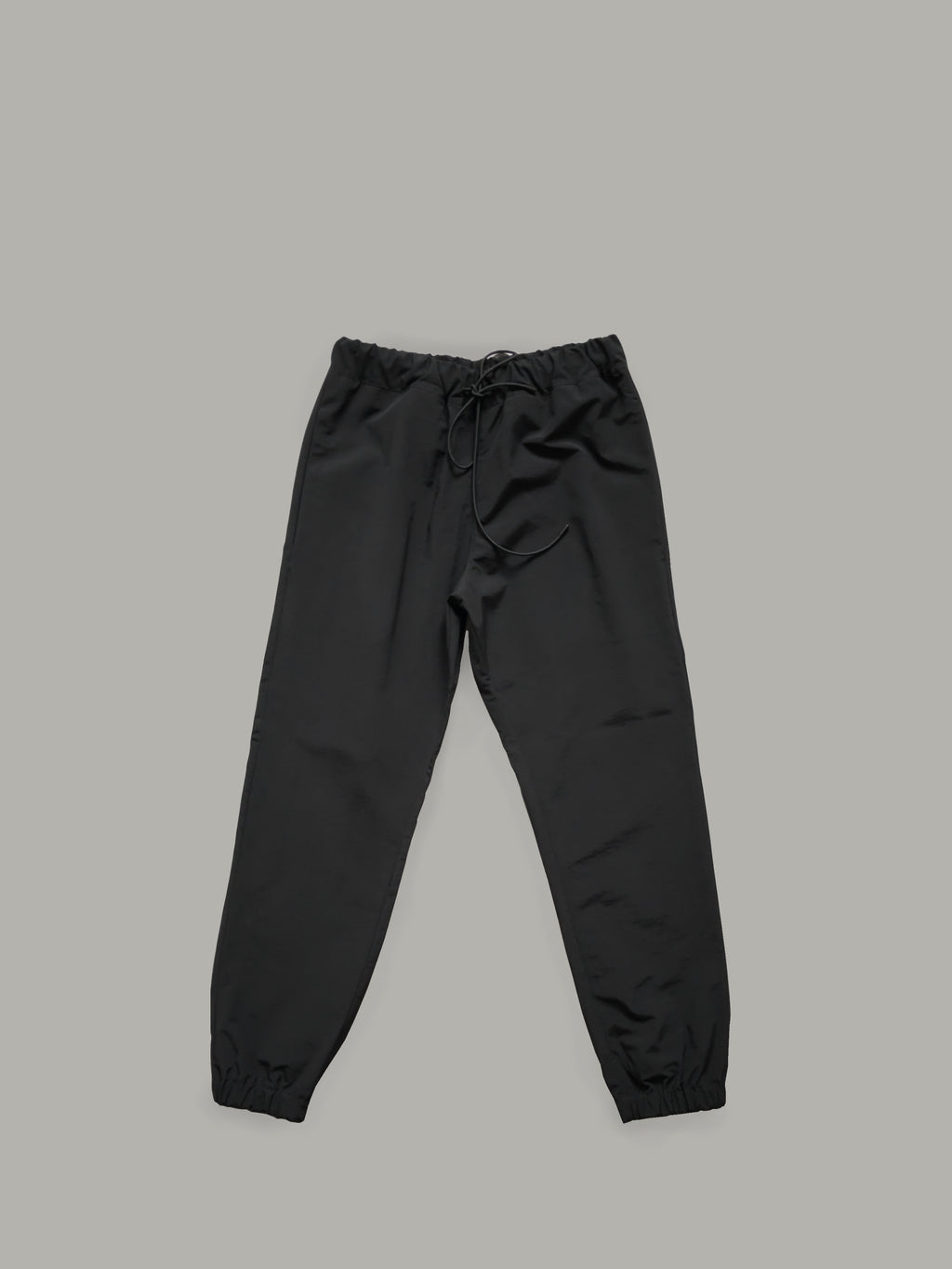 WATER RESISTANT NYLON TROUSERS WITH ADJUSTABLE WAISTBAND