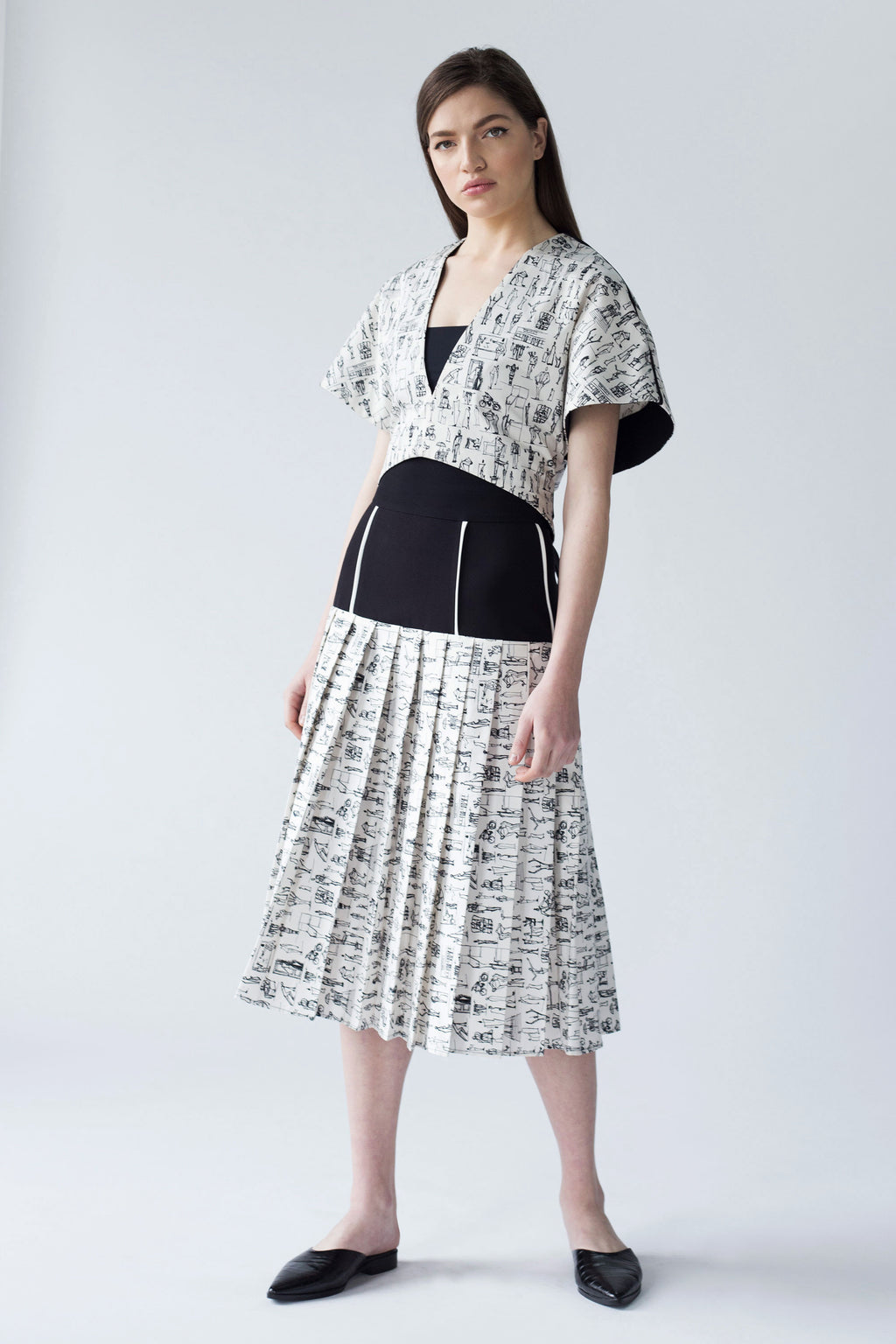 PLEATED PANEL SKIRT WITH CONTRASTING EDGE