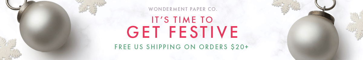 The complete holiday collection by Wonderment Paper Co including Christmas photo cards, greeting cards, gift wrap, and more.