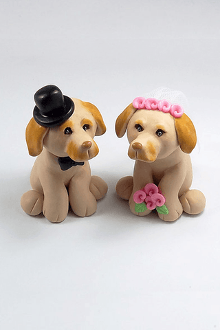 Custom made clay wedding cake toppers shaped as two family dogs