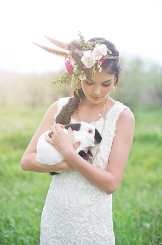 Lovely Bride in Wedding Dress and Floral Hair Piece Holding Pet Bunny Rabbit for Photo by Shannon Von Eschen