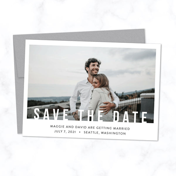 Minimal Save the Date Card with Photo and Modern Bold Typography shown with Silver Envelope