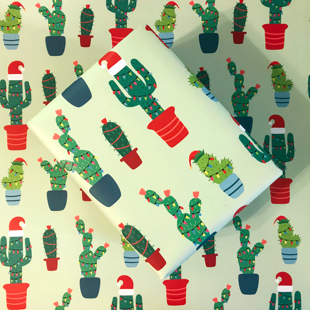 Christmas Cactus Gift Wrap - Box Wrapped in Gift Wrap on top of Wrapping Paper Sheet with Festive Cactus Pattern
