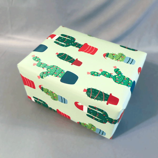 "Christmas Cactus Holiday Gift Wrap - Shown wrapped in a box sized 9"" x 6"" x 4"""