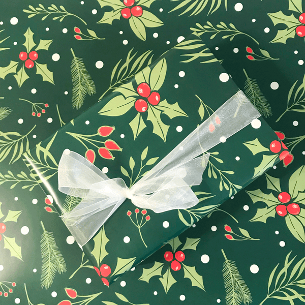 Green Holly Berry Print Holiday Gift Wrap - Designer Wrapping Paper Sheets - Wrapped Gift Box with White Ribbon on top of Large Gift Wrap Sheet