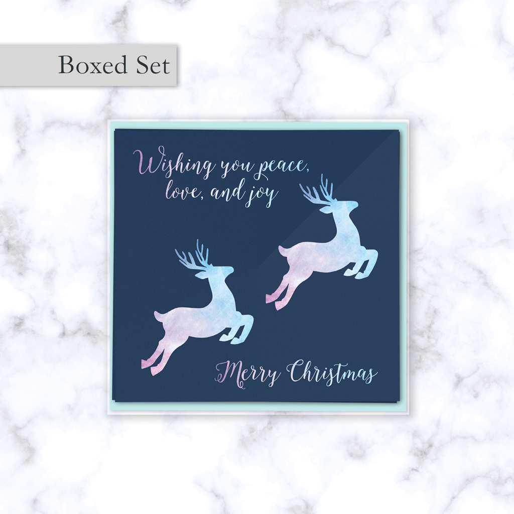 Leaping Reindeer Boxed Christmas Card Set with Watercolor Textured Reindeer in Pink and Blue - Envelope Included