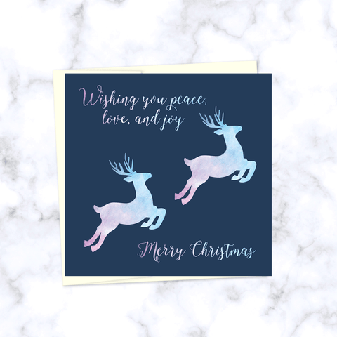 Leaping Reindeer Square Folded Christmas Card with Watercolor Textured Reindeer in Pink and Blue - Envelope Included