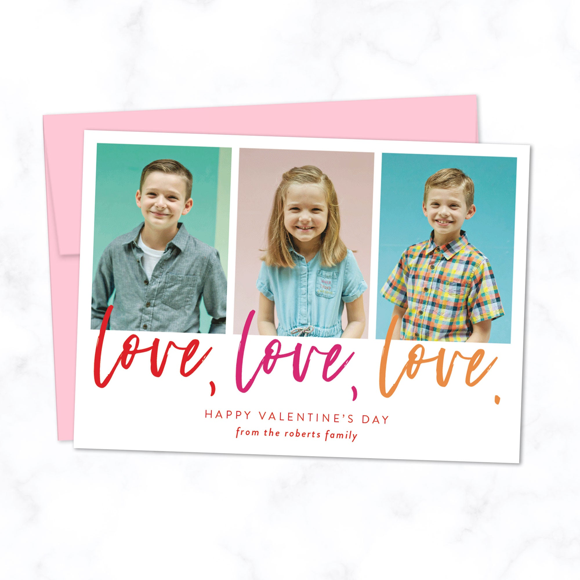 Custom Valentine's Day Photo Card with 3 Photo Frames and Love Love Love typography in colorful script. Printed A7 cards with light pink envelopes.