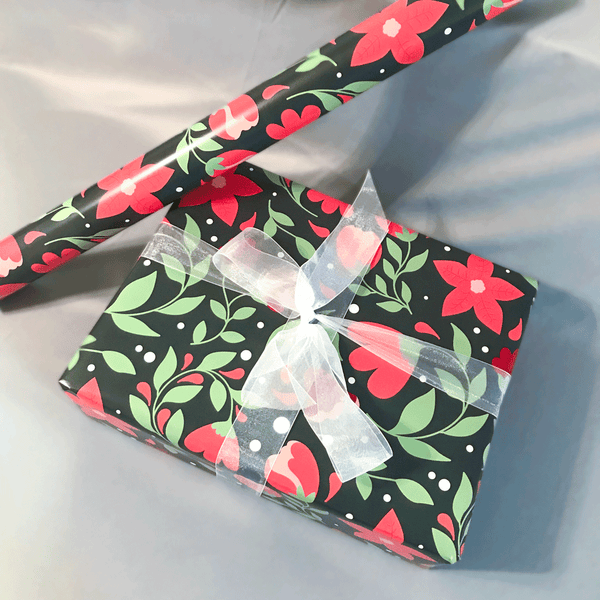 Red Poinsettia Floral Print Holiday Gift Wrap - Designer Wrapping Paper Sheets - Wrapped Gift Box with Ribbon Next to Roll