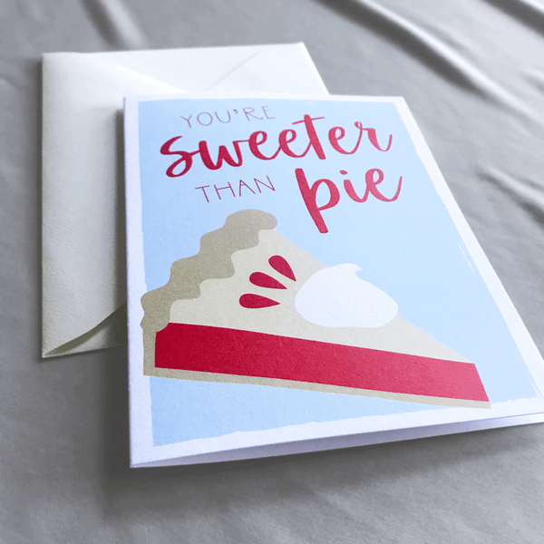 Sweeter than Pie Greeting Card with Illustrated Slice of Pie over Light Blue Background - A2 Folded Blank Card with Cream Envelope - Close up shows texture