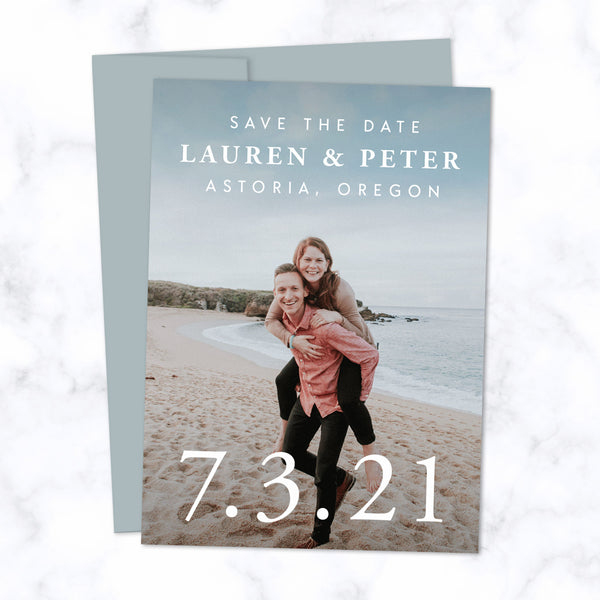 Classic Type Save the Date Cards with Full Frame Photo, Extra Large Date and Minimal Modern Typography shown with Dusty Blue Envelope