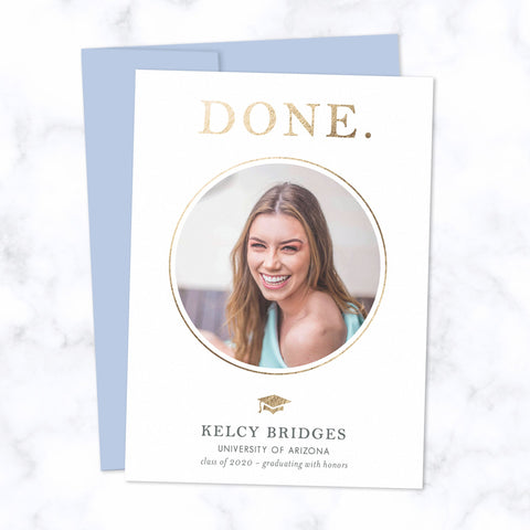 "Graduation Announcement Card with circle shaped photo frame, metallic gold foil ""DONE"" and grad cap, with white background and blue envelope"
