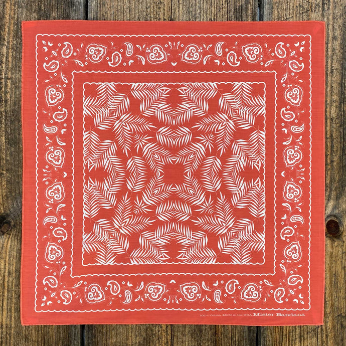Our classic Wild Palms design, now in silky coral red. Inspired by the traditional cowboy scarf, this bandana easily ties into a Western knot, or pairs great with our Bison Leather Woggle. Material: 100% silky pima cotton. Provenance: printed and assembled in North Carolina. 21.5