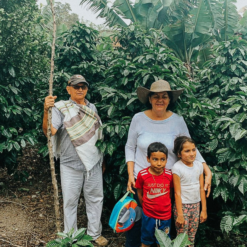 Maria Rosa Perez and her family on the their farm.