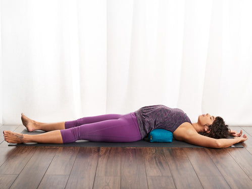 lying over a bolster (as shown) for extra support