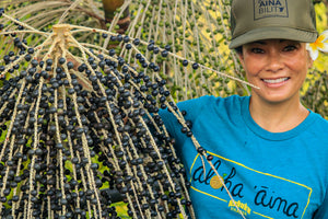 Kylie, one of the founders, with a fresh bunch of berries