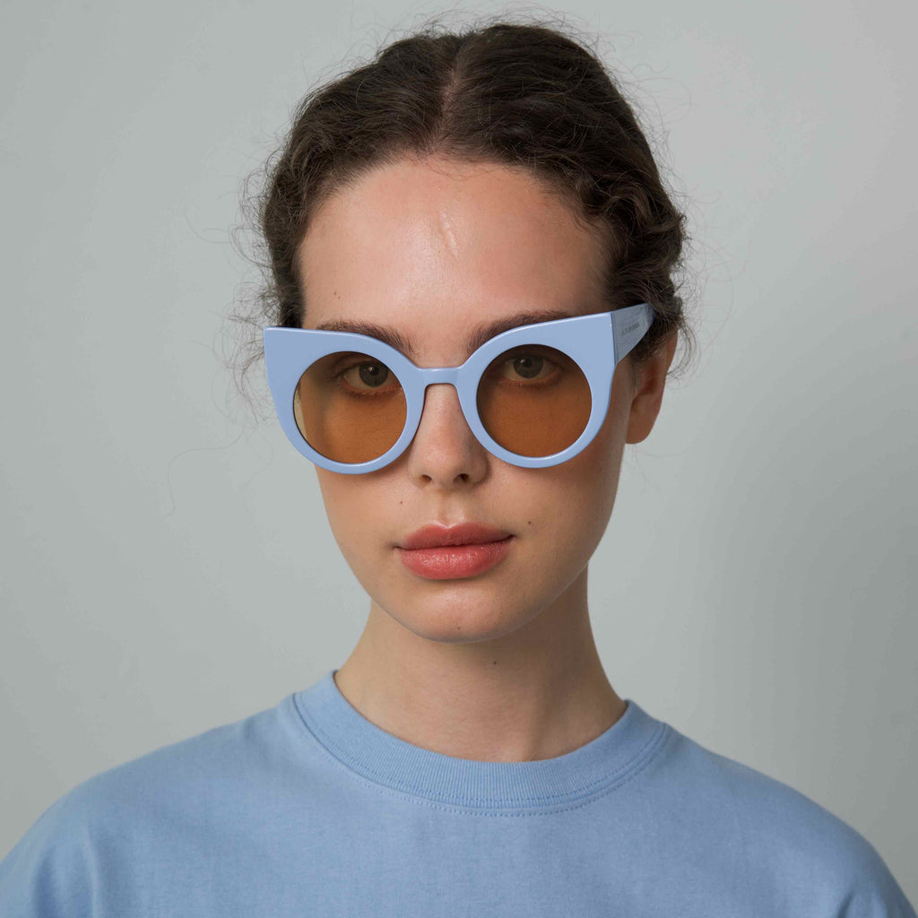CURIOUS Baby Blue frame + Amber lenses