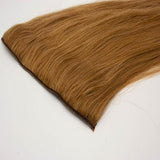 Clip in straight light brown hair extensions
