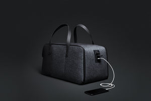 Travel Fusion Anti-theft Travel Duffel with USB charging port, security cable, combination lock, and water resistant exterior
