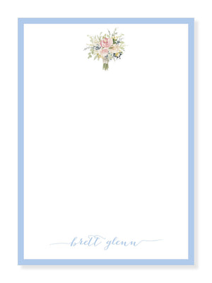 Bouquet and Blue Notepad