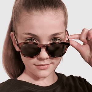 ava wearing mihi kids sunglasses - the bedford design