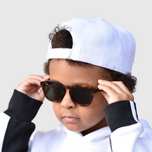 Load image into Gallery viewer, tate wearing mihi kids sunglasses - the bedford design
