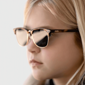 lexi wearing mihi kids sunglasses - the brooklyn design