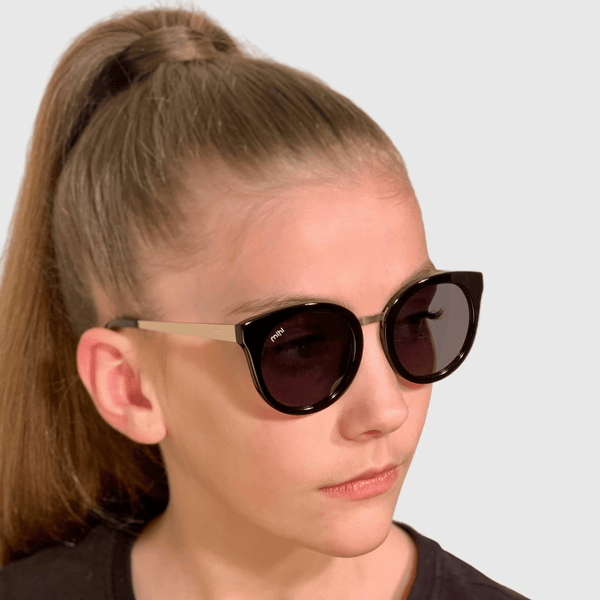 ava wearing mihi kids sunglasses - the madison design