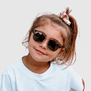 sienna wearing mihi kids sunglasses - the brooklyn design