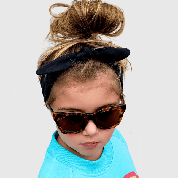 sienna wearing mihi kids sunglasses - the hamptons design