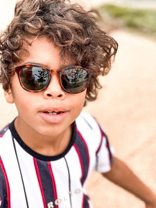 oliver wearing mihi kids sunglasses - the bedford design