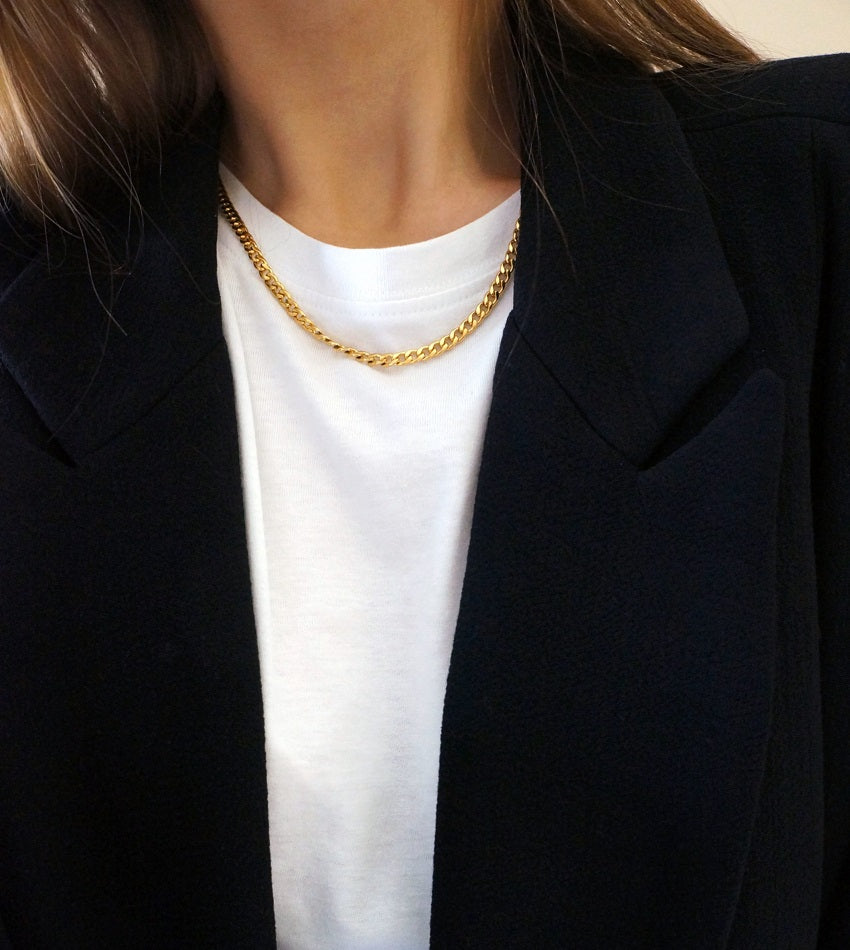 Gold color necklace with a freshwater pearl