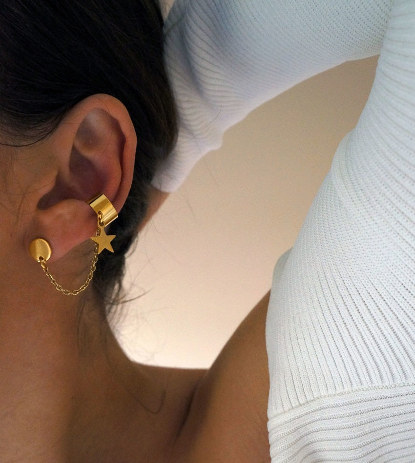 Stainless steel star earring set with an ear cuff in gold